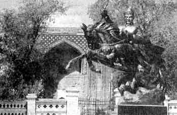 Photograph showing new bronze statue of Tughluq Tömur Khan at the front of his mazar