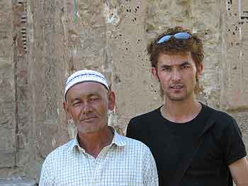 Photograph of interpreter and tomb custodian (left) of the Tughluq T&ouml;mur Khan <i>mazar</i> in Huocheng in 2004.